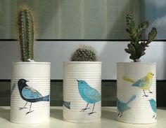 Upcycle those tin cans into plant pots and put a bird on it for good measure!
