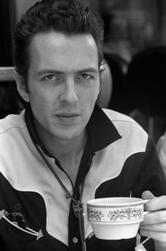 Joe Strummer-my idol, being both punk and English, drinking tea