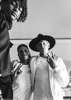 Famous friends: Musician Cody Simpson (R), 19, was seen hanging out with Will Smith's son Jaden (far left), 18, in a fun snap shared to Instagram on Friday