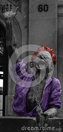 Shot of the sculpture of  a fountain in Barcelona in black and white, painted in red and purple Barcelona, Catalunya, Spain