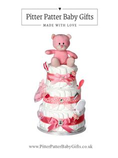 Signature Luxury Three Tier Baby Pink Nappy Cake - Our signature range nappy cakes are beautifully decorated and filled with those baby essentials, this three tier colour coordinated nappy cake combines elegance and practicality in one.  This truly is a gift you will be proud to give. Visit www.PitterPatterBabyGifts.co.uk for our complete selection of gifts.