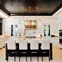 Tuthill Architecture - kitchens - double ovens, warming drawer, wood panel refrigerator, u shaped kitchen, espresso beadboard ceiling, walnut ceiling, beadboard, island pendants, kitchen countertops, sink in kitchen island, stainless steel appliances, limestone tiles, limestone kitchen floor, mosaic tiles, mosaic backsplash, pot filler, upholstered barstools, mercury