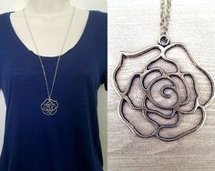 Necklace details:  • Pendant is antique silver-colored filigree flower • Pendant is 1.5 in height and 1.5 in width • Chain is antique silver-plated tiny flat soldered cable chain 2x1.4mm • Necklace is 30 with 2 extender chain and lobster clasp closure • Lead safe, nickel safe • Base metal of chain is brass  Other information:  • Every purchase from our shop supports nature-related organizations • This necklace is part of our Into the Woods collection, and supports rainforest conservation in…