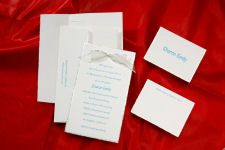 This beautiful hand-torn silver feather edged invitation on bright white paper has matching feather edged envelopes. Shown with optional bow Z3046.
