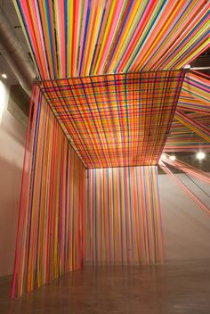 "flagging tape installation by Megan Geckler: ""Every step you take, every move you make,"" 2010"