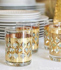 Pretty gold details add glamor to the glassware - Traditional Home® / Photo: Emily Followill / Designer: Melanie Turner