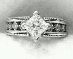 My ring. Love the princess cut center stone with a kite setting and side stones. My fiance had the center stone set that way...very nice and different. :-)