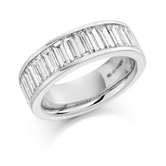 This is a ring that is guaranteed to be noticed! Baguette cut diamonds totalling 2 carats in a channel setting along a generous platinum band. Vintage Diamond, Vintage Rings, Eternity Rings, 2 Carat, Classic Beauty, Baguette, Precious Metals, Ring Designs, Diamond Cuts