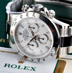 Close-up of a stainless steel Rolex Daytona white dial watch in courtesy of Rolex Daytona Gold, Rolex Daytona Ceramic, Rolex Cosmograph Daytona, Gold Rolex, Rolex Submariner, Rolex Daytona Steel, Rolex Gmt, Men's Watches, Fine Watches