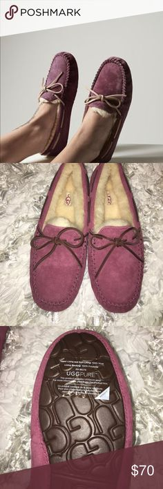 Ugg loafer Dakota A fixed leather lace-and-bow contrasts the soft suede of this beloved moccasin. Fully lined with natural wool and fitted with a durable rubber sole, the Dakota cushions feet on the sofa and the street. Color is called mystic purple but are more of a darkish Pink. This are new without box 📦.🌺offers welcomed!  Water-resistant Silkee suede Leather lace with fixed bow UGGpure™ wool lining UGGpure™ wool insole Rubber outsole UGG Shoes Flats & Loafers
