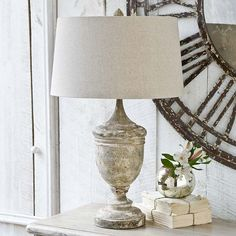 """This gesso wood vase table lamp base offers a rustic accent in a living room or bedroom. Its carved, weathered base is topped with a neutral oatmeal drum shade.  Lamp measures 18"""" round x 29""""H.  This item is not returnable, except in the unlikely event of defect or damage.  Free Shipping On This Item!!"""