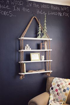 diy shelving with rope and small boards. love the full chalkboard wall too