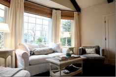 sitting room in master, window treatments, blinds placed right under rod (hiding the blank wall space)