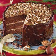 Southern Living - This Turtle Cake is a decadent treat worth indulging in. Enjoy the caramel filling in between layers of chocolate velvet cake with chocolate ganache icing on the sides and chopped pecans on top. Chocolate Velvet Cake, Chocolate Turtle Cakes, Chocolate Caramel Cake, Chocolate Ganache, Caramel Icing, Cupcakes, Cupcake Cakes, Cake Recipes, Dessert Recipes