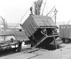 Loading rail borne coal onto a Spritsail Barge for onwards transport.