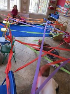 Extend Don Freeman's A Rainbow of My Own with this weaving through a rainbow movement experience ages 3-5 (F.2.1) (F.2.2.)