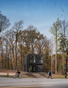 Bard College Media Lab comprises four shipping containers that are stacked two wide and two high, forming a larger rectangular structure.