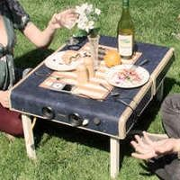 old suitcase transformed into a picnic table.   Everything stores inside.  Legs fold in.