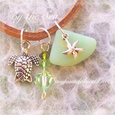 Sea Glass Charm Necklace ***RESERVED*** This beautiful necklace features Authenic sea glass, silver charms and Sworvski Crystals. By the Sea is a collection of jewelry inspired by the ocean. #Handcraftedjewelry by #MyFoundObjects