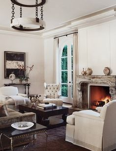 Distressed-look fireplace mantle. Seen on desiretoinspire.net