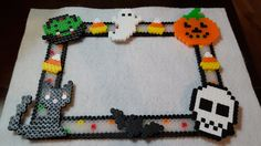 Halloween themed picture frame constructed with perler beads. Back of frame includes magnetic tape strips to attach to any magnetic surface.