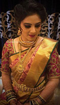 Lakshmi looks breathtaking for her Beegara Oota ceremony. Makeup and hairstyle by Vejetha for Swank Studio. Red lips. Jhumkis. South Indian bride. Eye makeup. Bridal jewelry. Bridal hair. Silk sari. Bridal Saree Blouse Design. Indian Bridal Makeup. Indian Bride. Gold Jewellery. Statement Blouse. Tamil bride. Telugu bride. Kannada bride. Hindu bride. Malayalee bride. Find us at