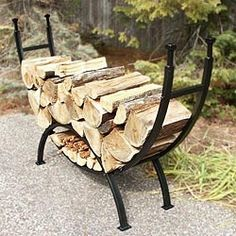 """69"""" Curved Log Rack.  This firewood rack is the ideal combination of form and function. Made of durable 1 1/4"""" square metal tubing, this rack is a stylish alternative compared to the classic log rack. The design makes the wood rack ideal for the hearth, the garage or by the house. This easy-to-assemble rack comes in a durable black finish and topped off with 4 beautifully designed finials.  #lograck #logracks #logs #firewood"""