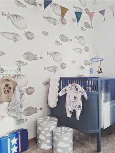 Fish wallpaper, navy crib, cloud baskets
