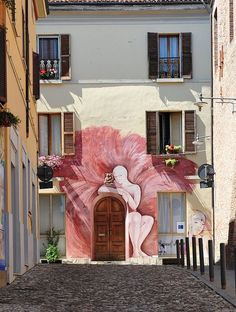 Dozza - an Italian comune in the province of Bologna, known for its festival of the painted wall, which takes place every two years. During this festival, famous national and international artists paint steady works on the walls of the houses