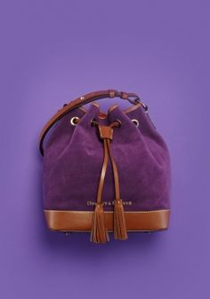 This Dooney & Burke suede drawstring bag is both stylish enough to pass into a trendy club or down-to-earth enough to take along on a road trip: