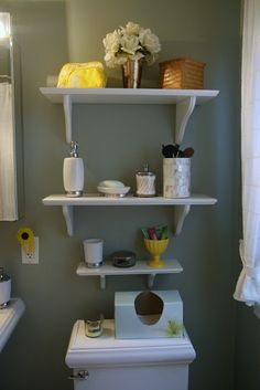 "Well organized shelves are pretty and functional in a small bath.  From ""Thrift and Shout: House Tour."""
