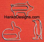 Animal/Fun Shaped Paper Clips  They could be listed under thangs that make me smile.  What a great gift for teachers.