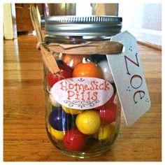 Homesick Pills. Cute idea for a graduation gift. Gum balls in a mason jar. Glue scrapbook paper to the lid to make a cute top!