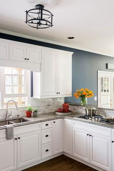 kitchen bright blue walls white cabinets subway tile absolute black granite counters. Black Bedroom Furniture Sets. Home Design Ideas