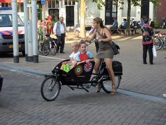 Bakfiets or work bikes in the Netherlands. The Dutch are so smart! I want one