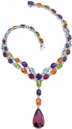 The Kaleidoscope Necklace contains a rainbow of natural gems, featuring a pear shape rubellite on a diamond necklace that is interspersed with amethysts, citrines, peridots, lolites and topaz in white gold by Robert Procop