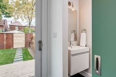 Views from mudroom out to rear yard and fence featuring recycled corrugated steel cladding, powder with sliding door Steel Cladding, Mudroom, Sliding Doors, Fence, Powder, Yard, Storage, House, Furniture