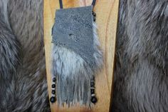 """Bag Dimensions 3"""" x 4"""" with tassels, 8"""" Necklace Strap Length 16"""" Olive Grey Spotted Nubuck Leather with Coyote Fur and Deerskin Leather Lace Strap Beaded Tassels are made of Gold Obsidian Stone Beads"""