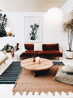 Modern living room with dark red couch and layered rugs. Boho Living Room, Home And Living, Living Room Decor, Modern Living, Living Area, Red Couch Living Room, Small Living, Living Rooms, Living Room Inspiration