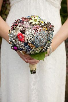 Wedding bouquet made from bride's mom and grandmother's brooches - very creative