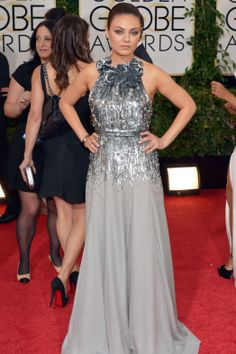 Mila Kunis wore Gucci Premiere at the Golden Globes 2014: Red-Carpet Arrivals. I liked the dress but wished they had done more with her hair... I realize it needs to be up due to the neckline on the dress but it was lacking for me. The rest she is gorgeous and I am just nit-picking!