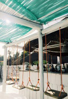 The beach club, La Popular in Tulum is nestled around tree surroundings.