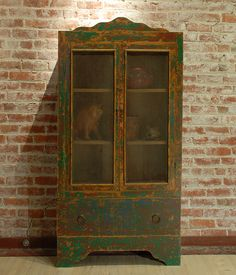 arly 20th century Mennonite trastero (kitchen cabinet) from Chihuahua, Mexico - circa 1930. from: http://www.colonialarts.com
