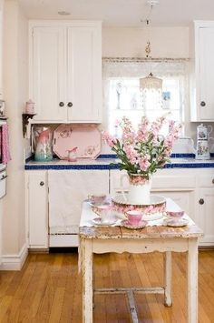 Cottage kitchen in pink and white; vintage table style; Upcycle, Recycle, Salvage, diy, thrift, flea, repurpose!  For vintage ideas and goods shop at Estate ReSale & ReDesign, Bonita Springs, FL