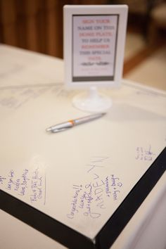Used a home plate as our guest book.....fall wedding orange and gray