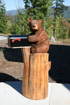 little bear carving holding a mailbox ... Better yet add old Wine barrel as mailbox the Bear is holding ... AWESOME!!! http://stromcarver.com/chainsaw-2