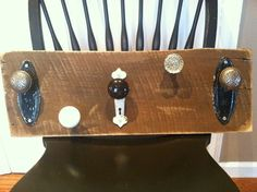 Door knob coat rack that I made on a stained piece of barn wood,added old knobs, plates