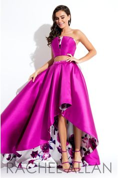 Rachel Allan 7576 is a two piece high low Mikado gown that has a strapless top with floral print accent and floral print lining that peeks out the high skirt front.