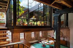 Caviar Warehouse reborn as a loft with a killer suspended courtyard The industrial style of the interior is all exposed brick, hardwood, steel and glass.
