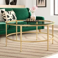 null You found your dream sofa (finally!). Now pair it with a coffee table that will take your living room setup to the next level. This round coffee table has a metal frame with six tapered legs and a circular support bar. Its antique gold finish adds a bit of shine to your space. The tempered glass adds to the open design of the table and provides an on-trend space for your plants, books, and mugs of coffee. The best part? This table arrives fully assembled.